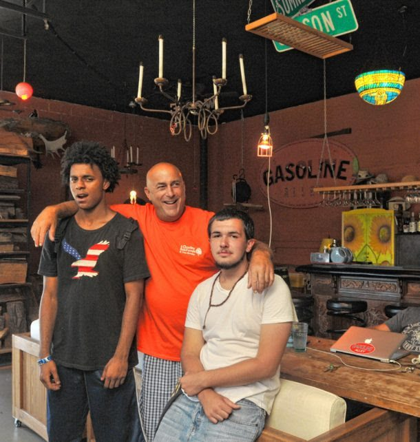 Joe Sibilia stands with left Olrando Taylor and Noah Ryan.